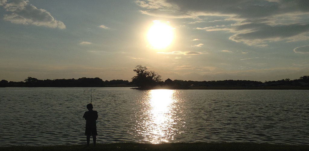 summer sunset boy fishing
