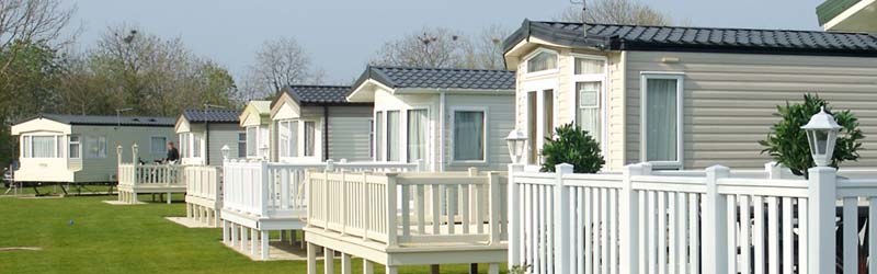 Manufactured Homes With White Fencing