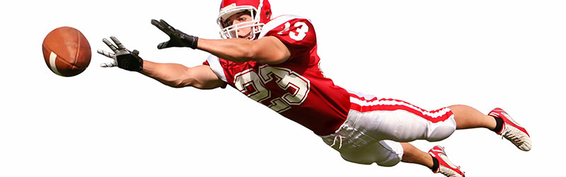 Football player diving for a catch