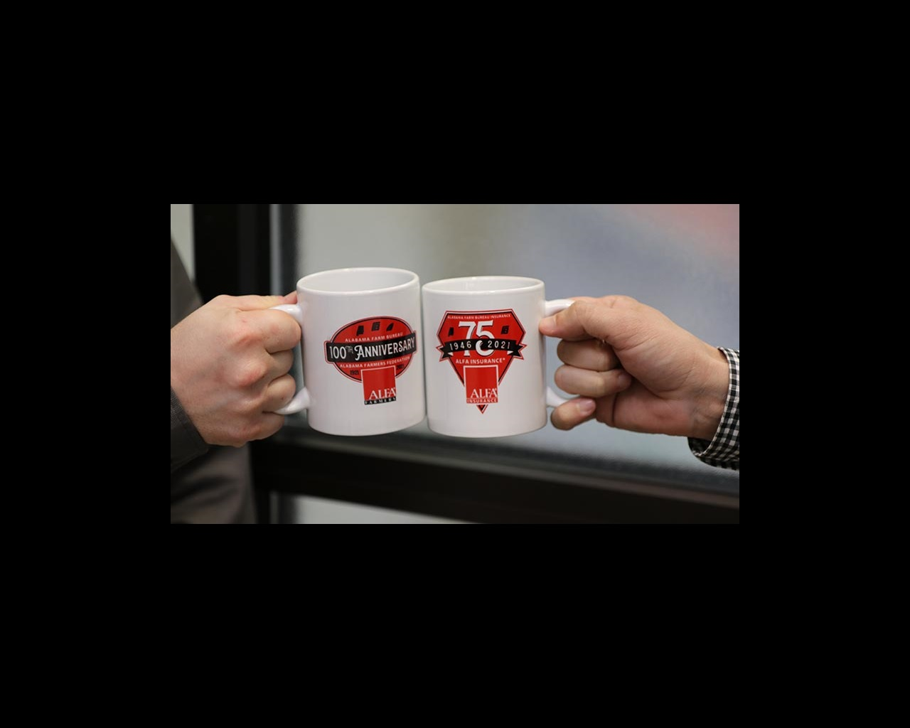 Two hands holding coffee mugs