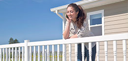 girl standing on deck of manufactured home