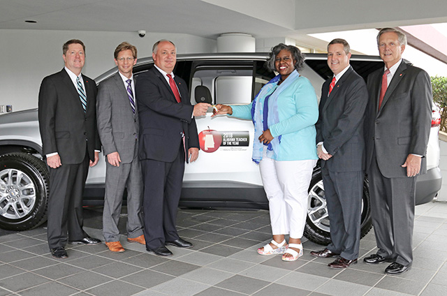 Photo of Teacher of the Year Zestlan Simmons receiving car from Alfa Insurance